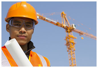 construction worker in front of a sky crane