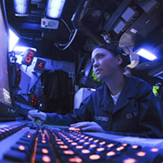 female military personnel at a command center computer